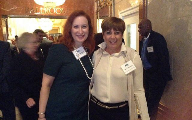 Erica Greenblatt, ADL director of development, networks with Sheri Whiteman of the host committee.