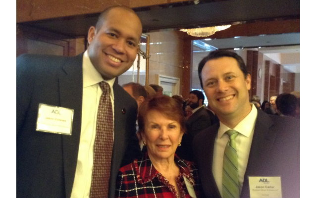 Honoree Jason Esteves chats with Georgia Supreme Court Justice Carol Hunstein and Jason Carter, jurisprudence luncheon co-chair.
