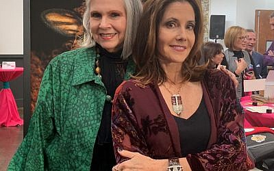 Honorary chair Martha Jo Katz greeted guests along with honoree Cynthia Good, who wore accessories by Vintage by Cathy, an Art Walk vendor at the event.