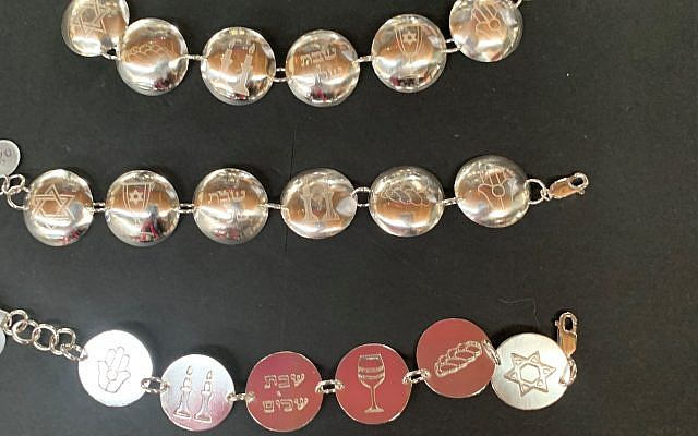 Leola Reis displayed sterling silver Judaica at the Art Walk.