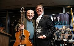 Musician Peter Yarrow poses with award winner, Michael Morris.