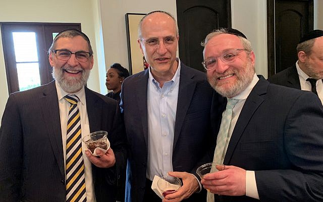 Kollel Rabbi Binyomin Friedman shares joy with Kollel learner attorney David Weisman and Kollel Rabbi Shlomo Gelbtuch, who motivates and molds the UGA and Georgia Tech student program.