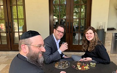 Co-Rosh Kollel Daniel Pransky, left, chats with Eric and Malka Adelman on the Goldstein patio.