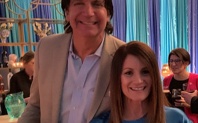 Eric Miller with event chair Nancy Miller, who wore turquoise to match designer Jim White's decor.