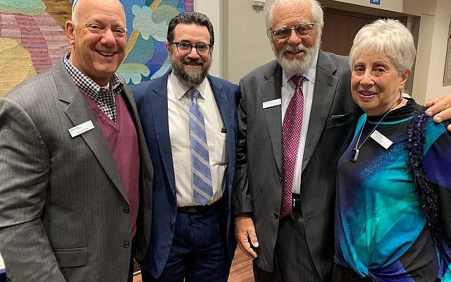 Board members from left: David Edlin, Rabbi Josh Heller, and MACoM Treasurer Sheldon Zimmerman pose with Wilma Asrael, mikvah guide.