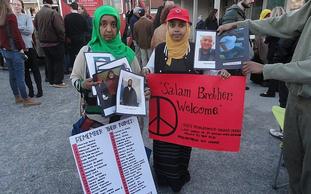 Muslim attendees with names and photos of Christchurch victims.