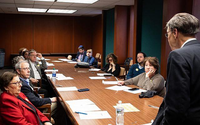Participants listen eagerly as Jeff Willard, co-chair of Tzedek Georgia, discusses legislation of importance.