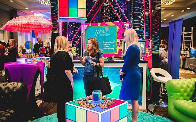 Exciting décor is on display in decorator booths, like this brightly colored lounge.