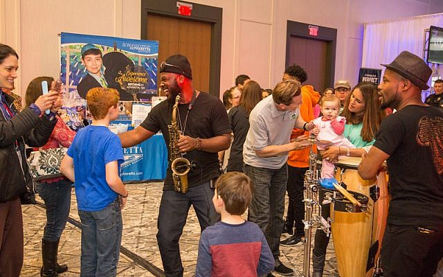 Atlanta Fever DJs combine with live musicians to create a one-of-a-kind entertainment experience for families.