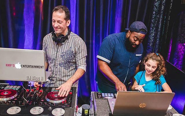 Learning some DJ moves in the Amp'd Entertainment booth at the Expo.