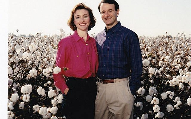 Deborah and Lou Jacobs in a cotton field in Cary, Miss.