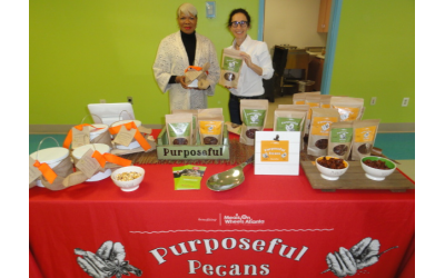 CEO Charlene Crusoe-Ingram, left, and Hillary Baker of Meals on Wheels, with some of their product.