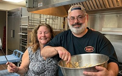 Lori and Marty Gilbert whip up a batch of matzah brie.