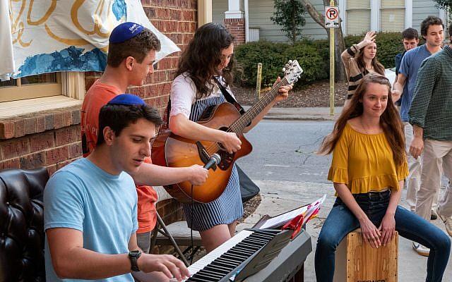 Students play music before Shabbat begins.