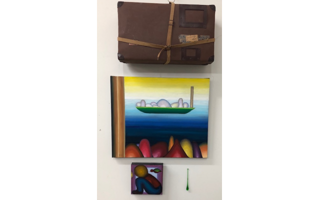 "Photo by Joel Barr // This grouping includes the suitcase Barr's father carried when escaping Poland and while he was a stowaway from Cuba to Florida in the 1920s. Below it are: ""Two Boats, Many Passengers"" and ""You are Always Free."""