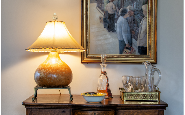 This gourd lamp and vintage glassware complement a favorite oil by Dale Kennington.