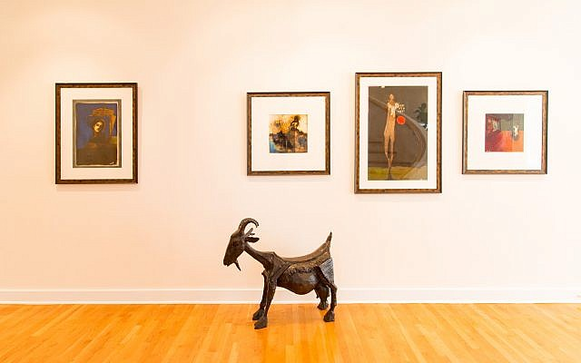This life-sized metal goat statue is forefront to four T.L. Lange paintings.