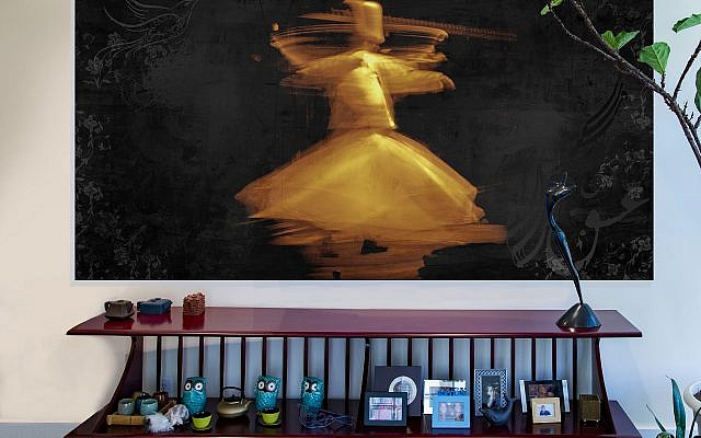 "The ""Whirling Dervish"" was created by Kamy as a mixed media encaustic. His own work is also on the walls at Rumi's Kitchen on Roswell Road in Sandy Springs."