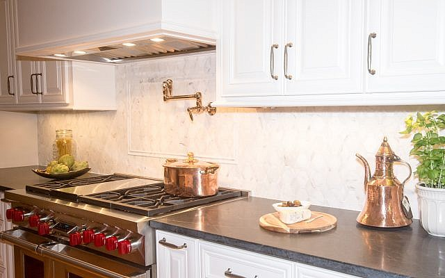 Good lighting and exciting cabinets and handles were on Alexis Solomon's short list for DIY kitchen projects. Contrast and weight were her recommendations when looking to accent a kitchen.