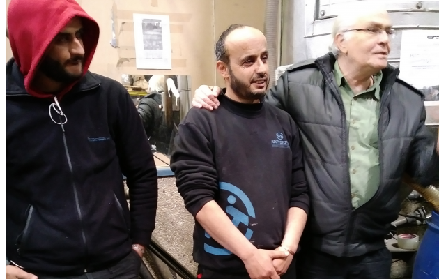 Israel Twito with Palestinian worker and his son.