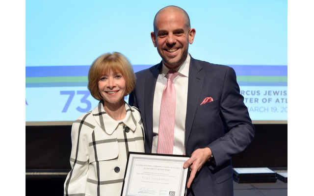 MJCCA CEO Jared Powers presents awards at the annual meeting to Nora Floersheim, Glenn Frank, Ari Weitz and Zak Elfenbein (on behalf of his program), among many others.