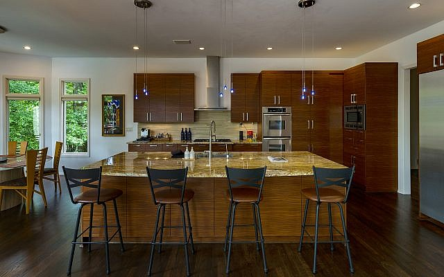 The Shulman kitchen features Lighting Loft fixtures and lacquered floral Lazy Susans he made as bar mitzvah favors.
