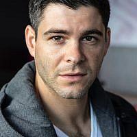 Adam's professional headshot is part of an impressive portfolio.