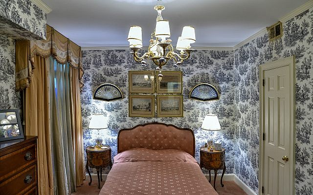 Grand Mary's private room to escape Grand Dad's snoring, is recreated on Peachtree Road. The Schumacher wallpaper and Dresden chandelier are Dwoskin touches. The fans are from the old downtown Rich's.
