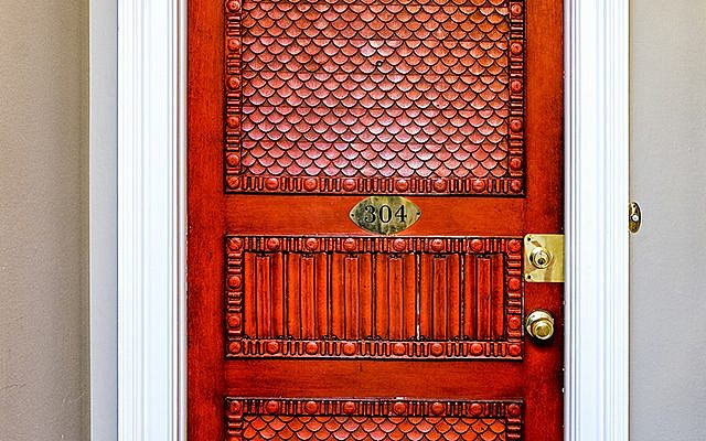Jean got special permission from her condo association to bring over the Dwoskin front door – custom designed and crafted in 10 layers.
