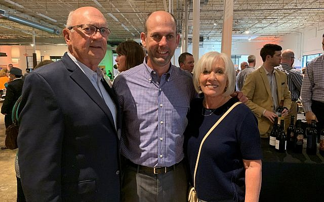 Donald and Joan Brown, both Tasting originators, surround son Mark, libations chair who arranged for the wine and spirit distributor contributions.