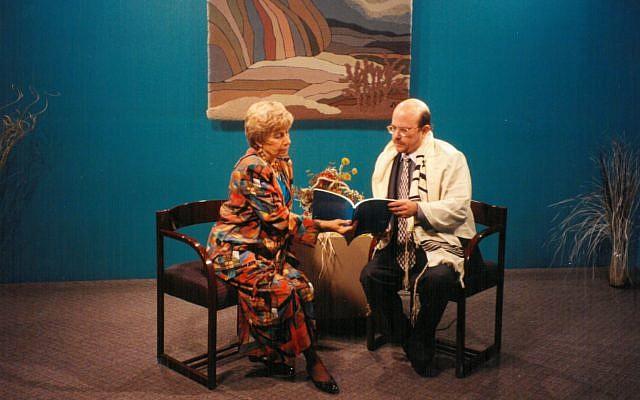 "Jan Epstein, host of ""Tikkun Olam,"" with Rabbi Steve Lebow of Temple Kol Emeth."