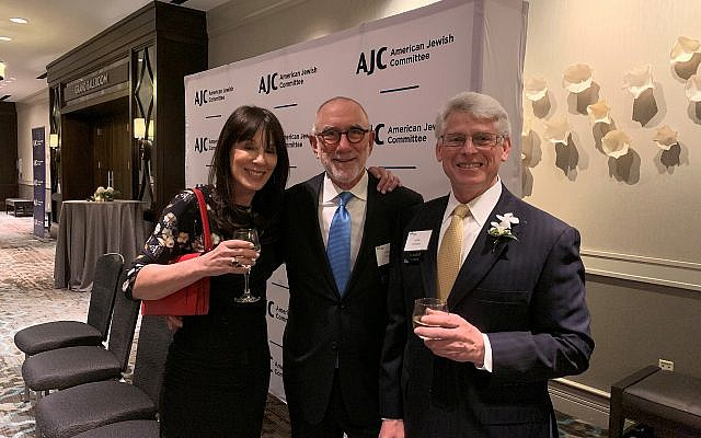 Current AJC president Melanie Nelkin along with Allan Nelkin and Lenny Silverstein, past AJC president, chat during the reception.