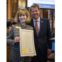 Photo by Duane Stork // Gov. Brian Kemp and Sally Levine display a Days of Remembrance proclamation.