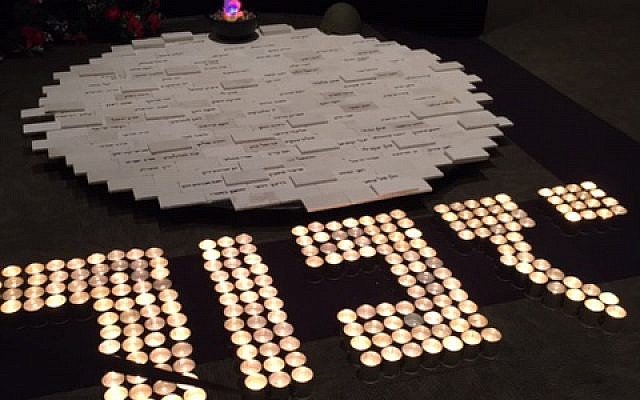 Memorial candles arranged to spell the Hebrew word Yizkor, to remember, outside the sanctuary at Ahavath Achim.
