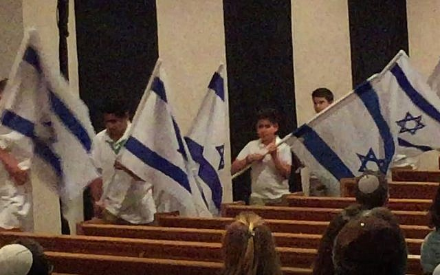 Israel Scouts carry Israeli flags into the sanctuary at Ahavath Achim.