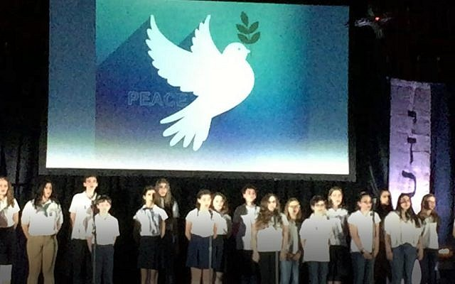 """Students from The Weber School sing the song """"Peace"""" during the annual community Yom Hazikaron commemoration."""