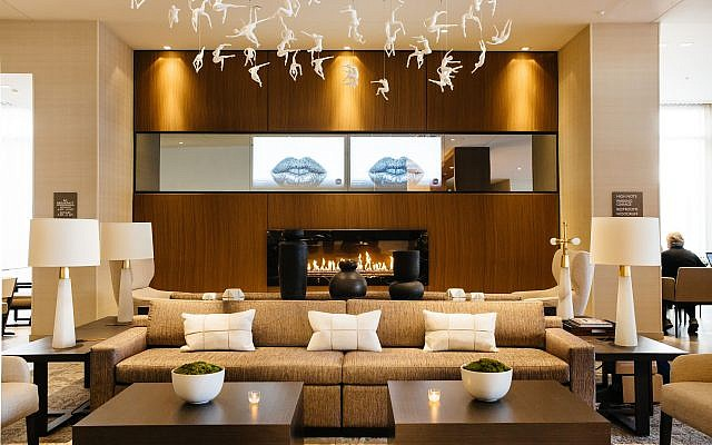 """AC Lobby's ceiling sculpture, """"The Movement,"""" reflects the hotel's location near the arts district."""