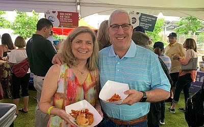Debbie and Andy Bauman, who is a Sandy Springs city councilman, celebrate their first Food That Rocks because they were in the middle of moving during last year's event.