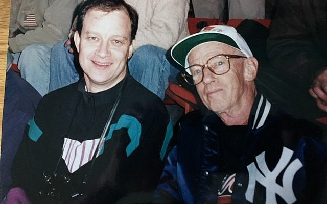 Dave Schechter and his father, Dan (right, displaying his allegiance by wearing his New York Yankees jacket over a borrowed Braves sweatshirt) at a 1996 World Series game in Atlanta.