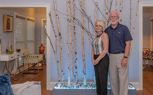 Julia and Ted Larrabee designed and built the forest box with imported birch trees from Colorado. The lighting at the bottom changes colors remotely.  Glamorous Julia  is a Russian Jewish emigre from Minsk, Belarus.