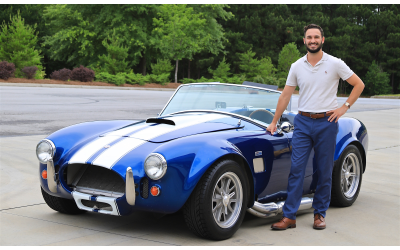 Feldman poses with a 1965 Shelby Cobra Replica.