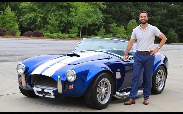 Feldman poses with a 1965 Shelby Cobra Replica.