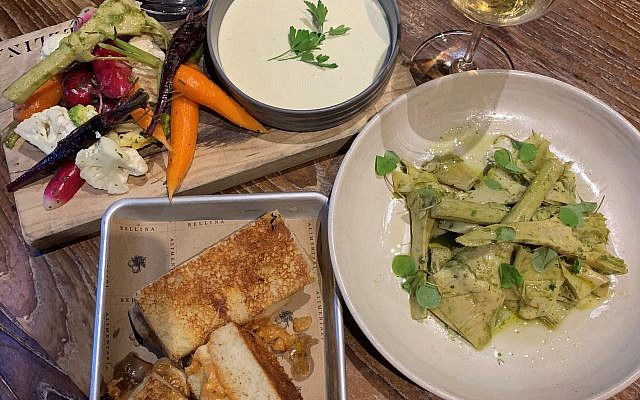"""From left, rainbow crunchy vegetable crudités, marinated artichokes ( a favorite!) and center """"adult grilled cheese"""" cavolfiore: roasted cauliflower, sundried tomatoes, shallots, artisanal cheese on schiacciata bread made in-house with potato water."""