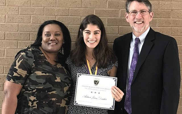 Addison Dascher shows the award and medal she received. With her are Joseph Reed, right, for whom the scholarship is named, and Derrica Williams of the Lakeside High School Foundation.