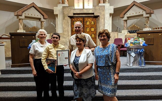 RuthE Levy, sponsor, judge, and owner of And Thou Shalt Read bookstore; Jackson Weatherill, second place winner; Vic Anapolle, Enlighten America chair; Helen Scherrer-Diamond and Lee Tanenbaum, B'nai B'rith co-presidents.