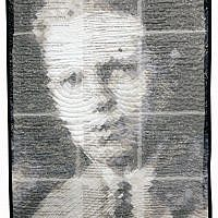 "Portrait of David Meilman, father of Maxine Hess. His 1925 Newton, Mass., high school yearbook picture was used to create a pattern of mosaic squares to which fabric was appliquéed. The resulting art quilt is ""In Memory of My Dad."""