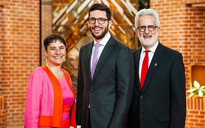 Micah Weiss at his graduation with Rabbi Deborah Waxman, Ph.D., president of Reconstructing Judaism, and Seth Rosen, chair of Reconstructing Judaism's Board of Governors.