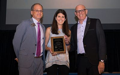 Award winner Jessica Sacks poses with Eric Robbins, left, and Board Chairman Mark Silberman.