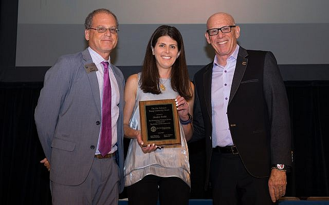 Award winner Jessica Sacks poses with Eric Robbins, left, and Board Chairman Mark Silberman.