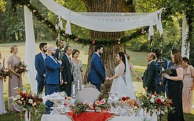 Photos by Teale Photography // Photo of the chuppah with the Persian table, Sofreh Aghd. Kamy Deljou designed the lace chuppah. The Persian table, akin to a Passover seder, was meticulously prepared.